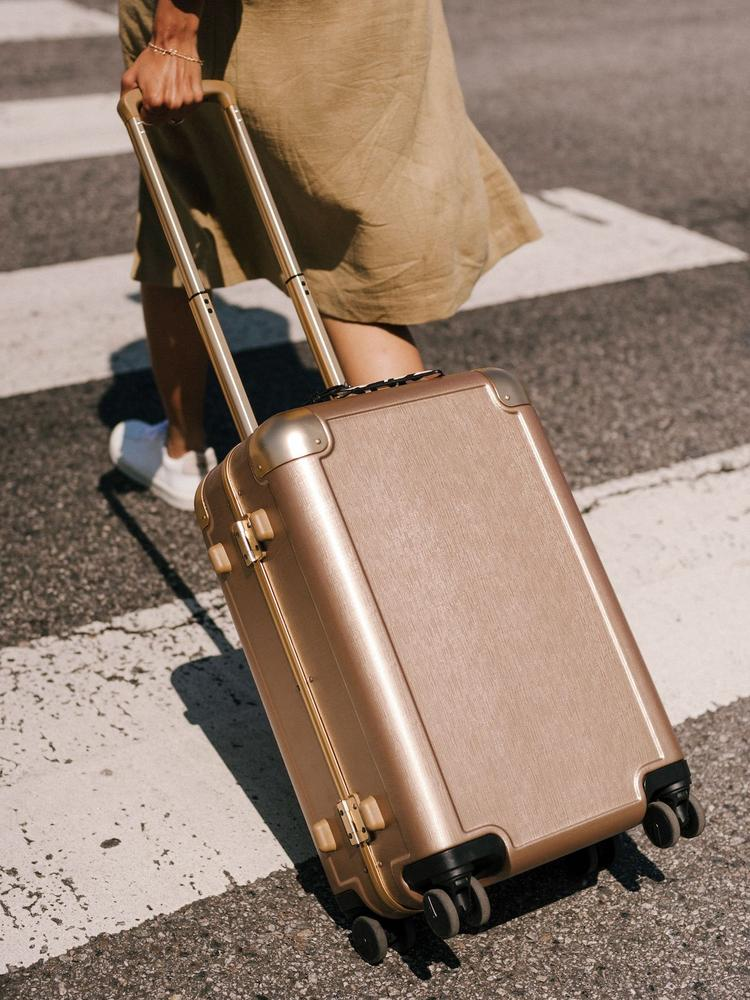 Calpack Luggage Review: Jen Atkin Carry On with lady on pedestrian crossing