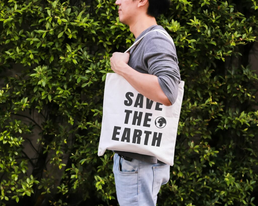 Eco friendly backpack review: a male carrying save the earth bag