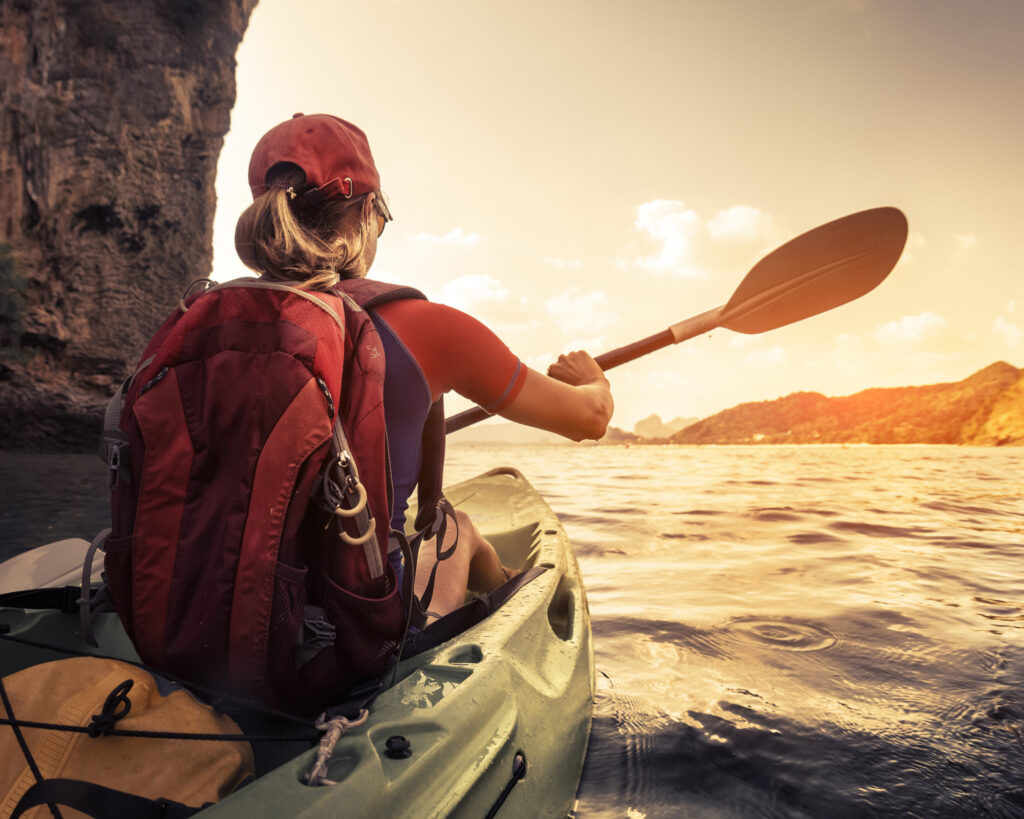 are north face backpacks waterproof: woman in a canoe