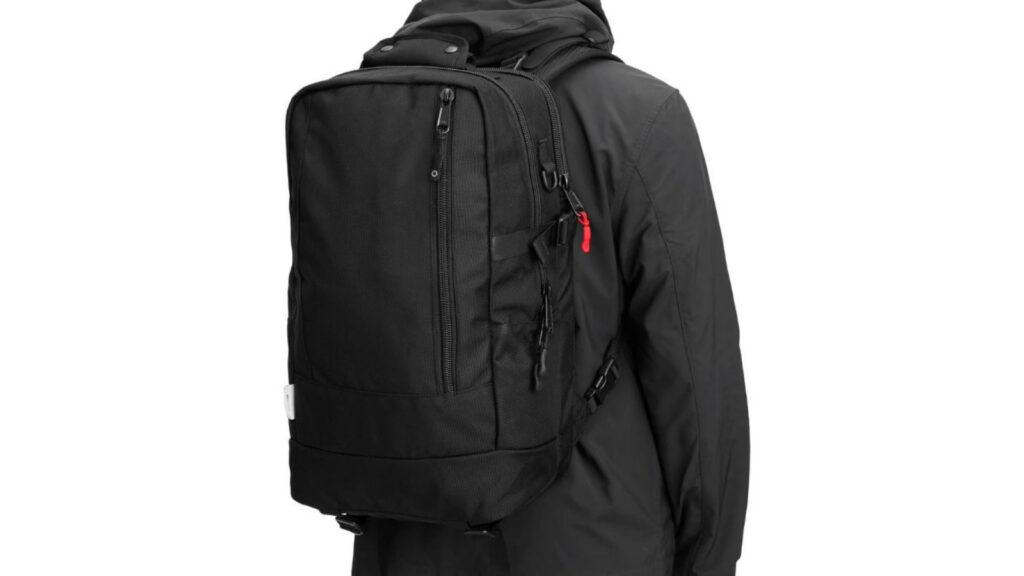 DPTCH Daypack Review: The DSPTCH Daypack on a male model