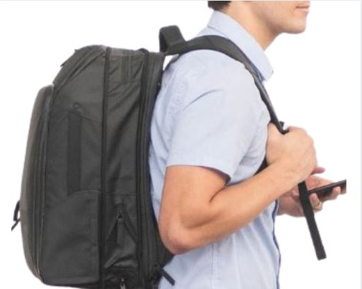 Nomatic Travel Pack review: a male wearing the Nomatic Travel Pack on his back