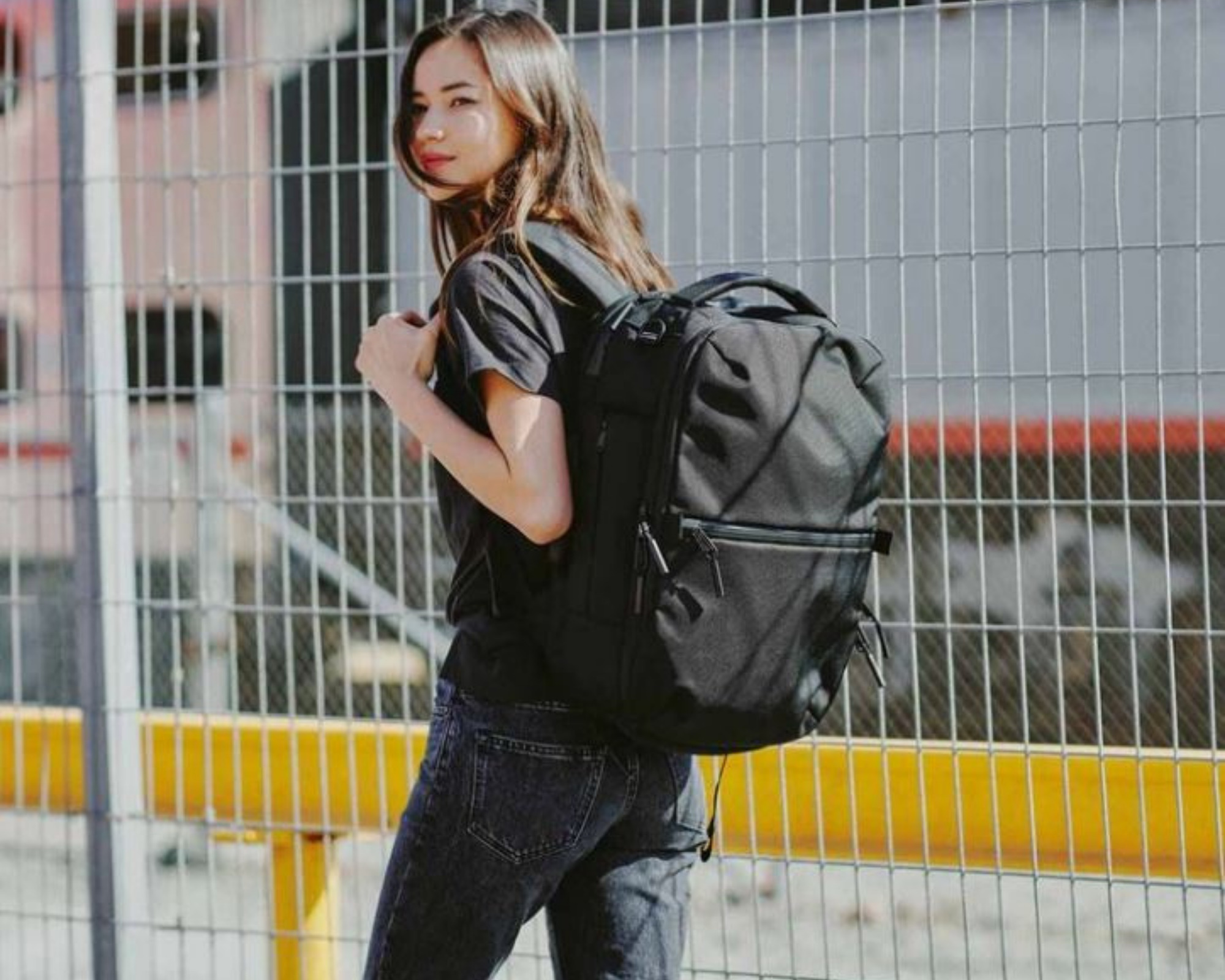 AER Travel Pack 2 review: A female model carrying the AER Travel pack 2