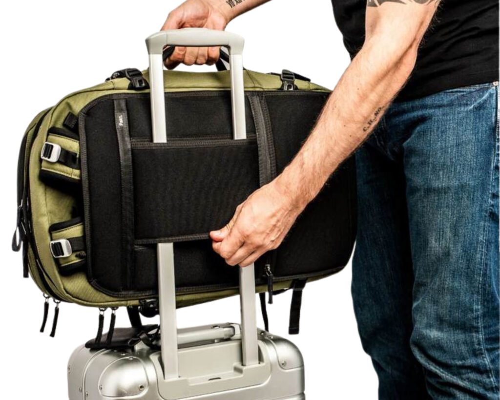 Pakt Travel backpack review: the Pakt Travel backpack attached to a suitcase