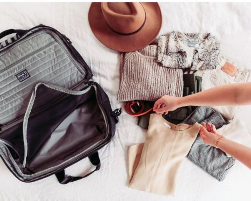 Pakt Travel backpack review: the interior of the Pakt Travel backpack with travel items beside it