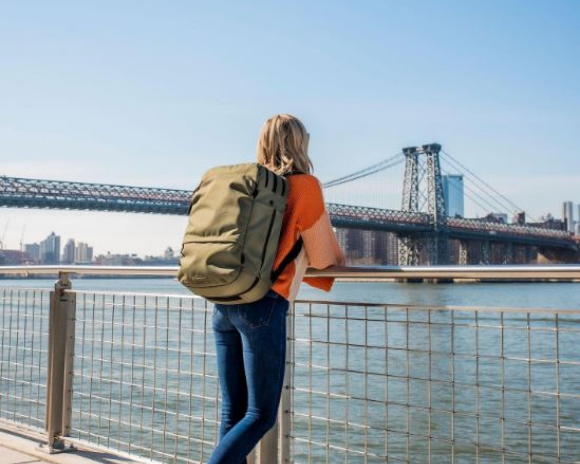Pakt Travel backpack review: a female carrying the Pakt Travel backpack
