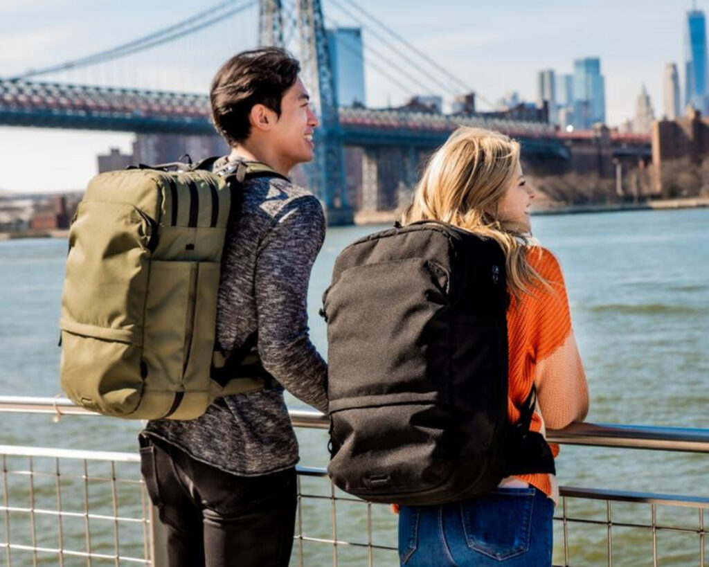 Pakt Travel backpack review: the Pakt Travel backpack carried by two models