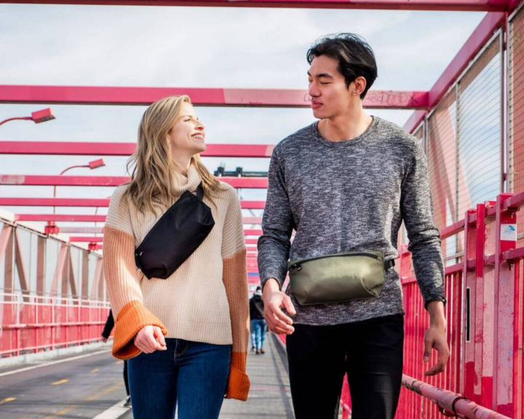 Pakt Travel backpack review: the Pakt Travel backpack fanny pack being worn by two models