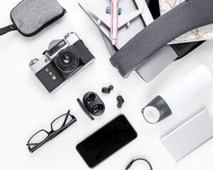 Best backpacks for techies: tech with a backpack on a table