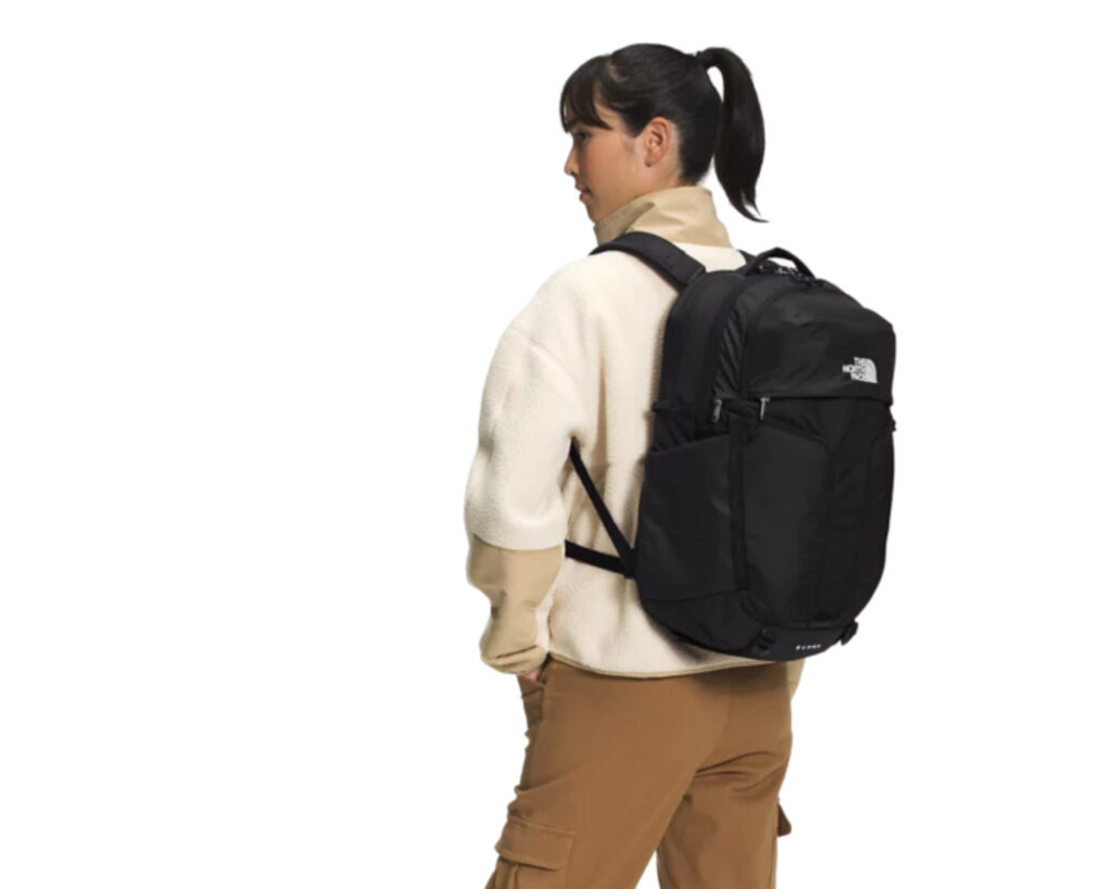 North Face Surge: a female carrying the North Face Surge on her back