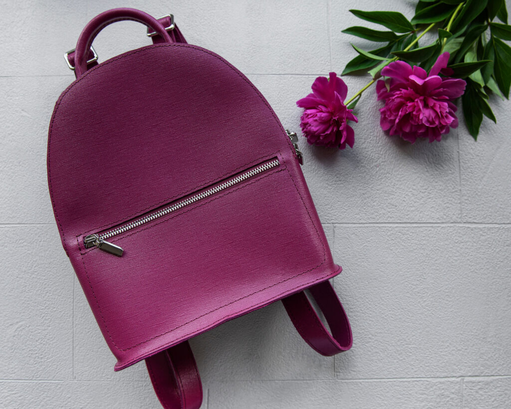 Best Small Backpacks for Women: a burgundy small bag