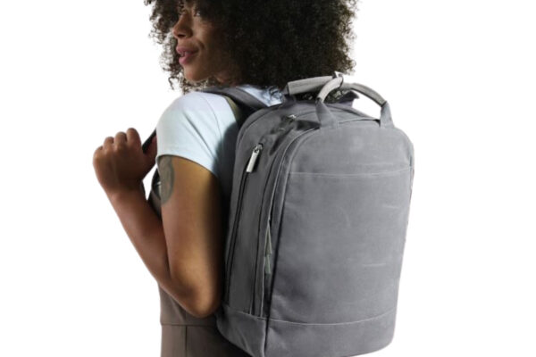Best Everyday Carry Backpack review: The Day Owl backpack on a female model
