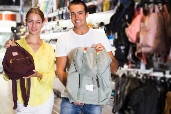 Different types of backpacks: two models holding backpacks