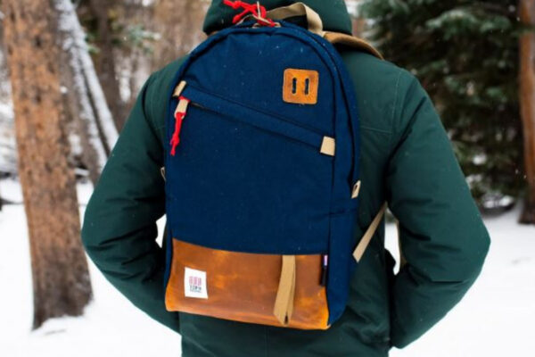 Topo Designs daypack review: a Male model wearing the Topo daypack