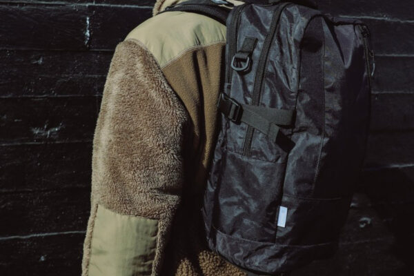 DSPTCH Daypack Review: Feature image of a man with bag